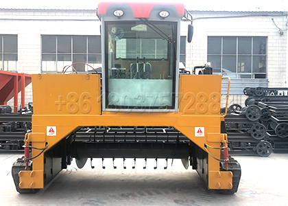 Mulch windrow turner